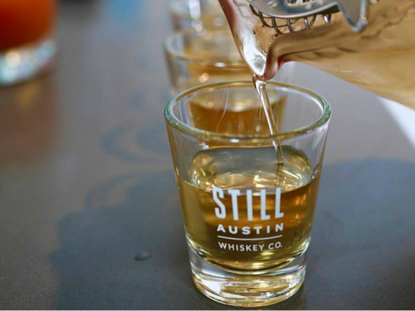 Still Austin Whiskey being poured