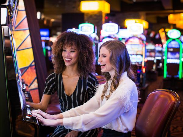 Women playing slot machines