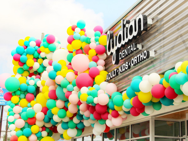 Lydian Dental sign with balloons