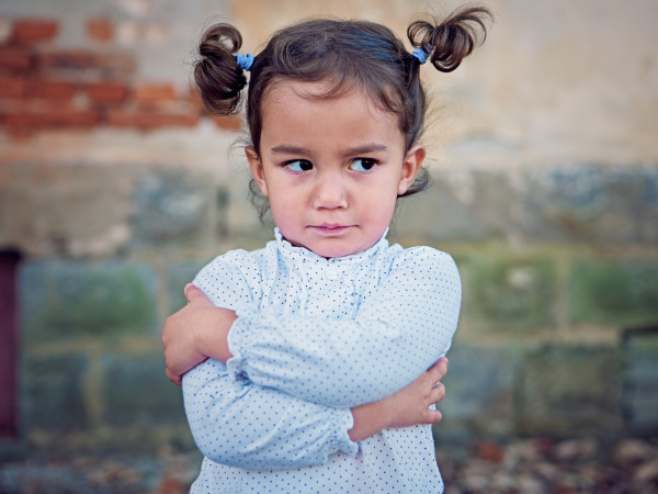 Little girl crossed arms