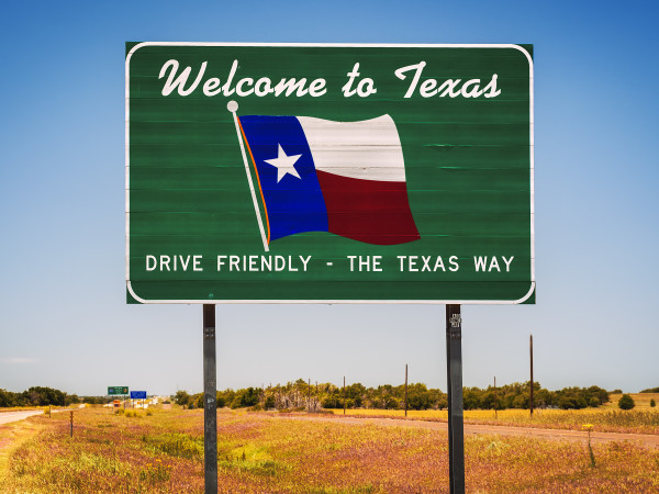 welcome to Texas highway road sign