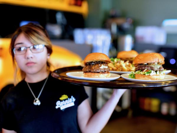 Bernie's Burger Bus Missouri City server with burgers