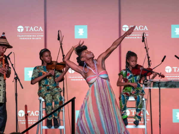 """Performance of """"Dallas: A Glimpse of Our Soul"""" by Will Richey and Friends (From left): S-Ankh Rasa, Indigenous American Drone Flute; Aissatouu and Kaira Rasa, Violinists; Iv Amenti, Movement"""