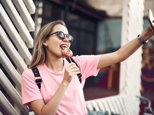 woman with candy lollipop selfie Houston