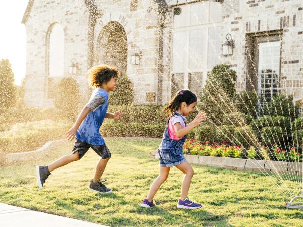 Kids playing in a sprinkler