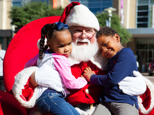 Little kids hugging Santa