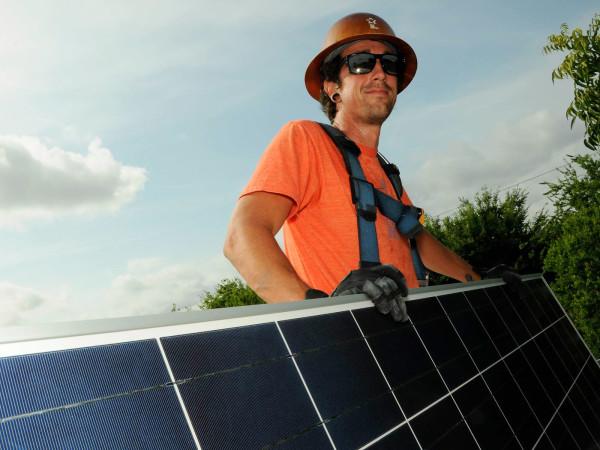 man with solar panels