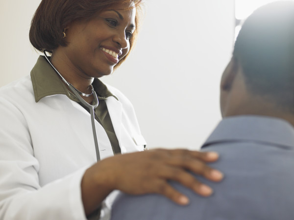 Female doctor talking to a patient