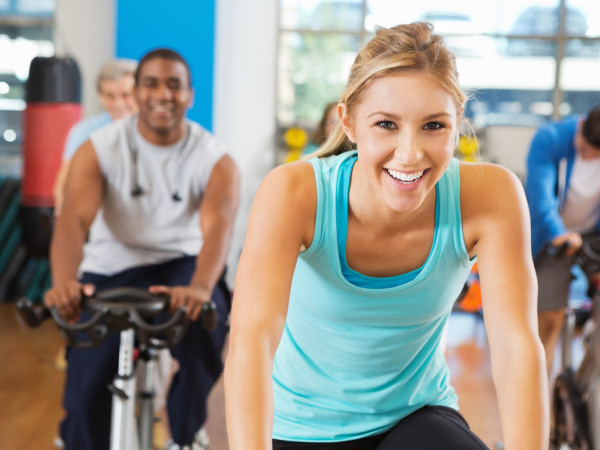 YMCA Houston cycling exercise woman on bike