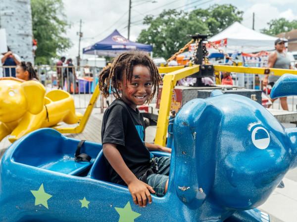 Juneteenth celebration Emancipation Park child kid girl ride
