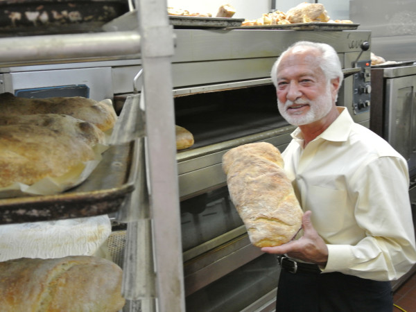 Vincent Mandola of Nino's and Vincent's, holding the Grand Prize, the Ciabatta loaf.