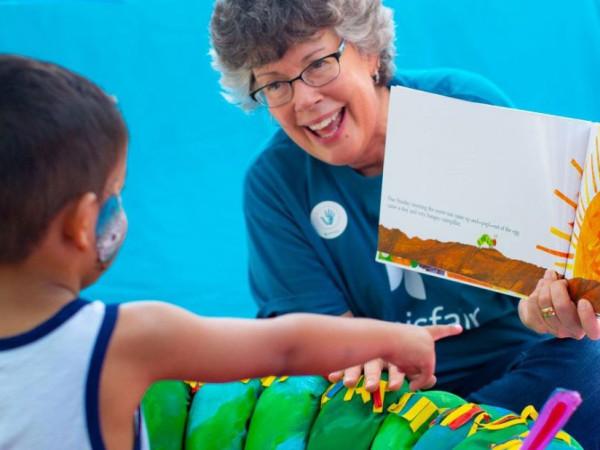 San Antonio Ms. Kim woman reading to boy San Antonio Virtual storytelling hemisfair