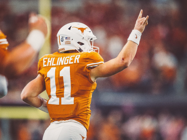 Sam Ehlinger UT Longhorns football player hook em hand