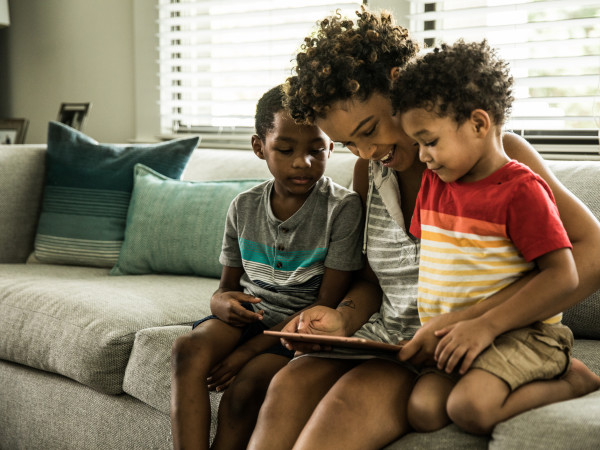 Mother and children using tablet