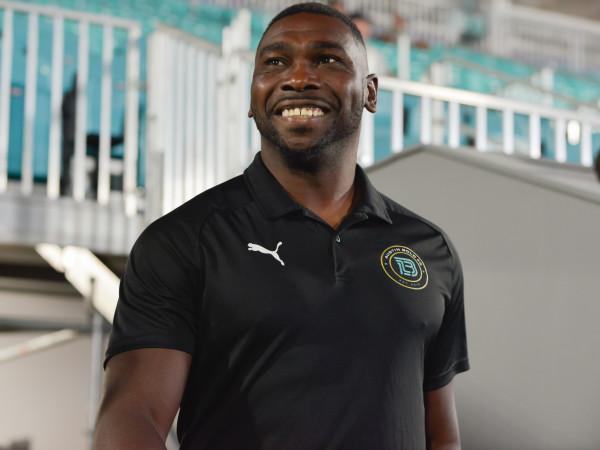 Austin Bold FC head coach Ryan Thompson smiles and makes an entrance.