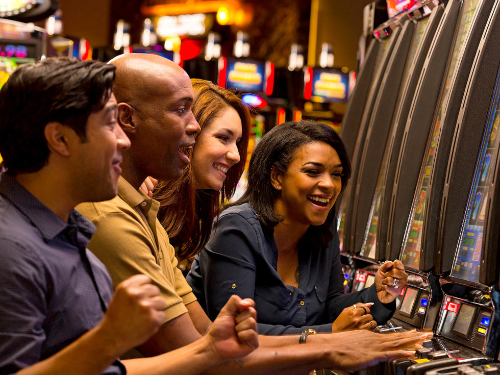People playing slot machines