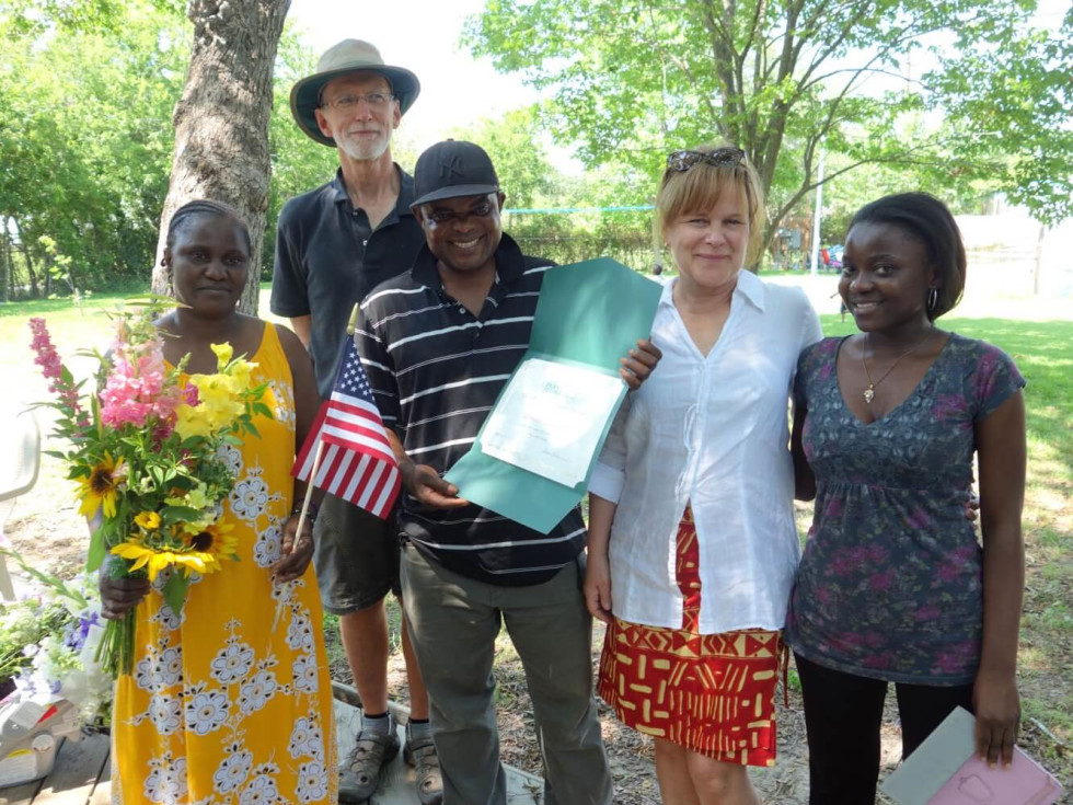 Plant It Forward president Teresa O'Donnell In white blouse with graduates from training program