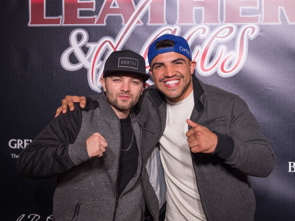 Victor Ortiz, right, and friend at Leather and Laces Friday night