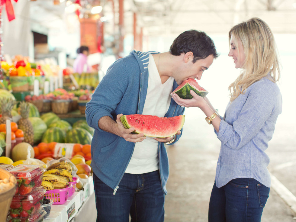 Couple eating watermelon