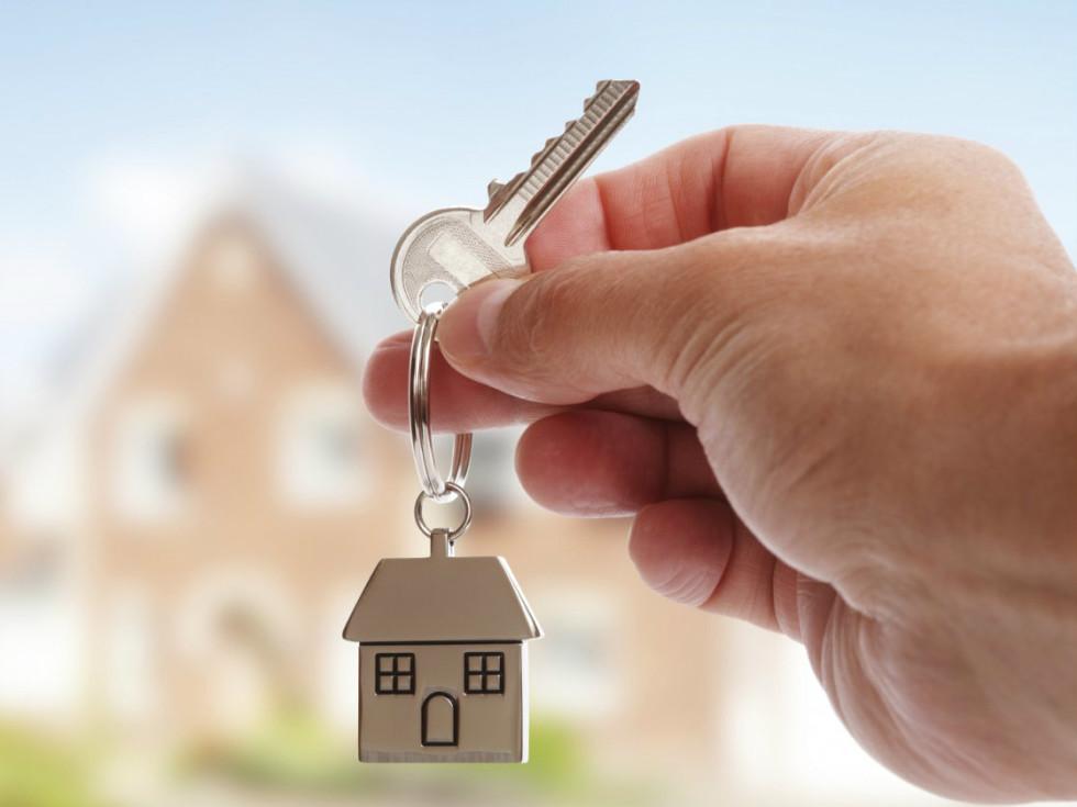 Hand holding a house key