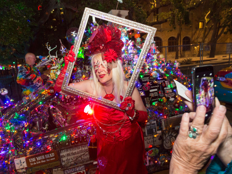 """Patti Paulson of Minnesota, owner of the """"Lipstick Car"""" has her picture taken in a frame during the Legendary Art Car Ball"""