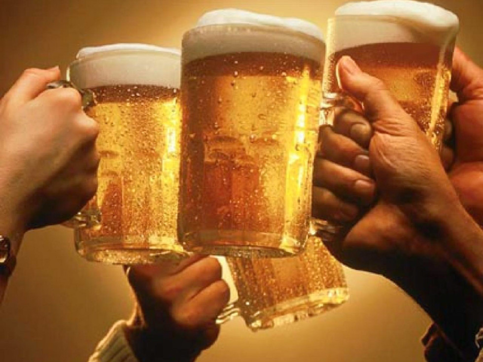 hands toasting with beer mugs