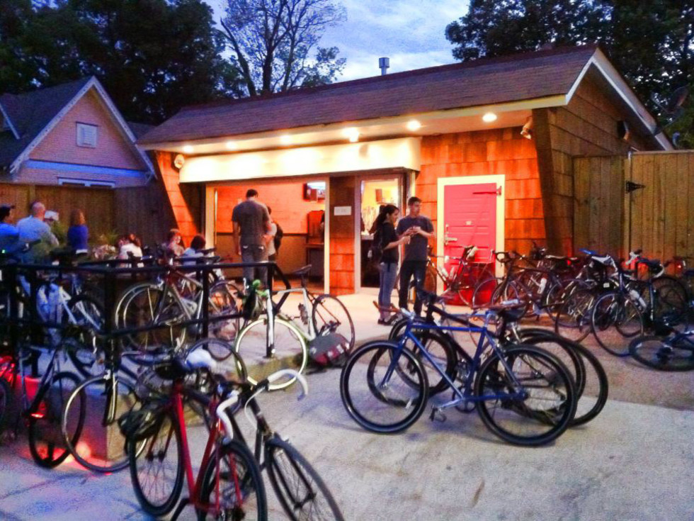 D&T Drive Inn front exterior at night with bicycles