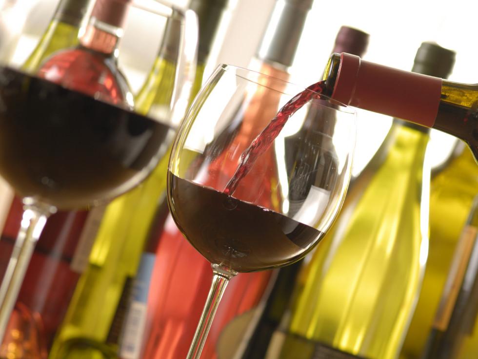 wine glasses pouring wine bottles of wine