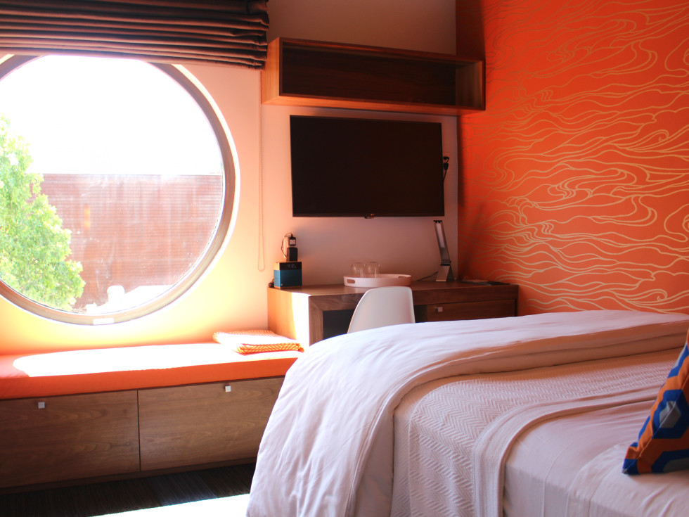 Hotel Eleven 11th Street Austin 2016 guest bedroom small orange
