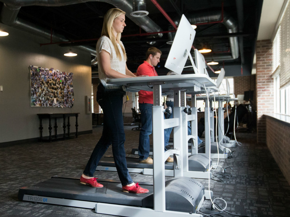 Girl at a treadmill desk
