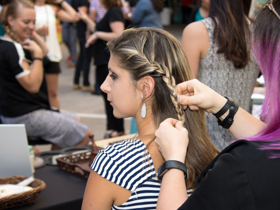 Guest having her hair braided at Hello Summer Social