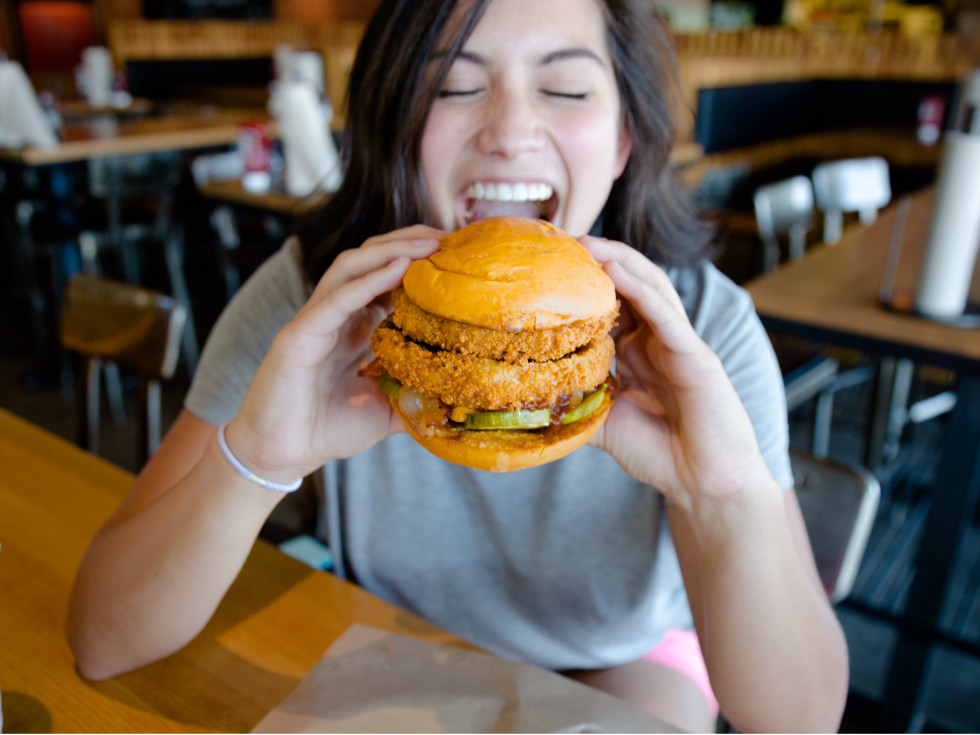 Woman eating the Lockhart Legend burger