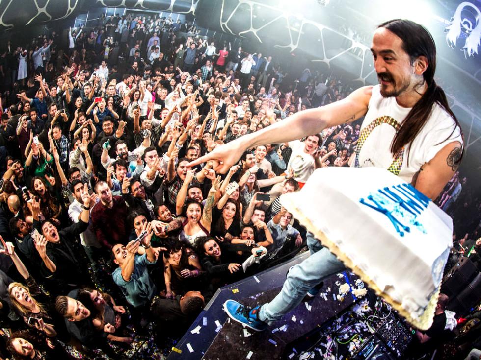 DJ Steve Aoki holding cake