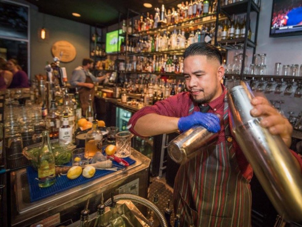 District Kitchen + Cocktails bartender shaking drink