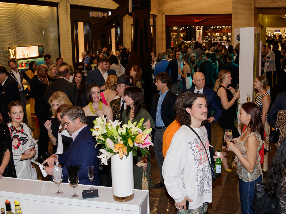 The crowd milled among luxury shops during the cocktail hour
