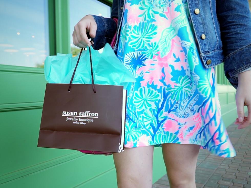 Girl holding Susan Saffron jewelry bag