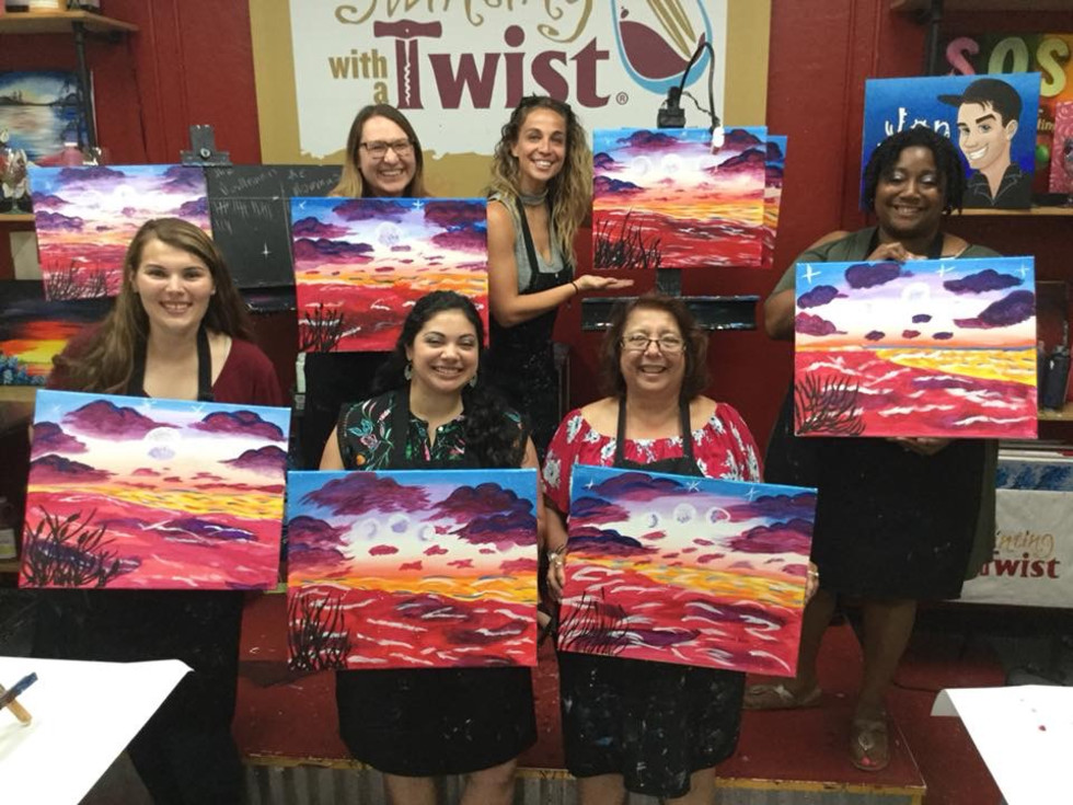 Women showing off their paintings