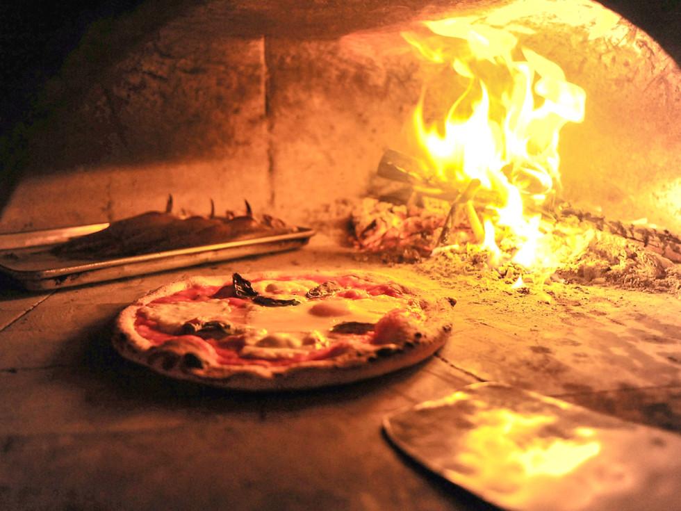 Debora Smail Da Marco Cucina E Vino pizza in pizza oven with fire