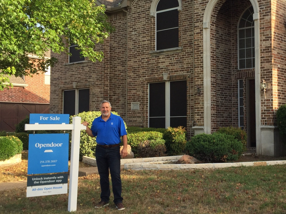 Opendoor employee Tony Hughes in front of a house