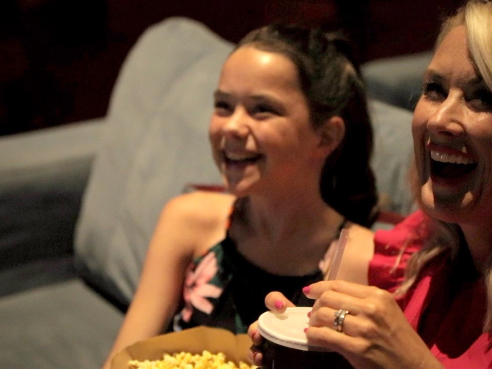 Cassie Freeman and her daughter Sloan at the Landmark Theater