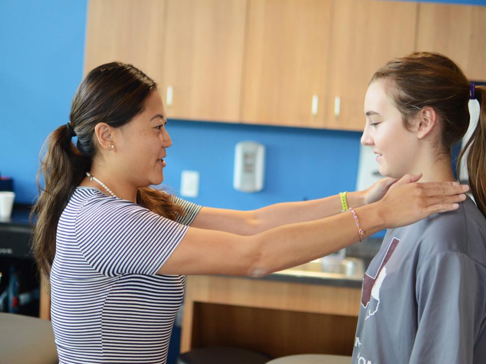 Doctor examining a teenage girl