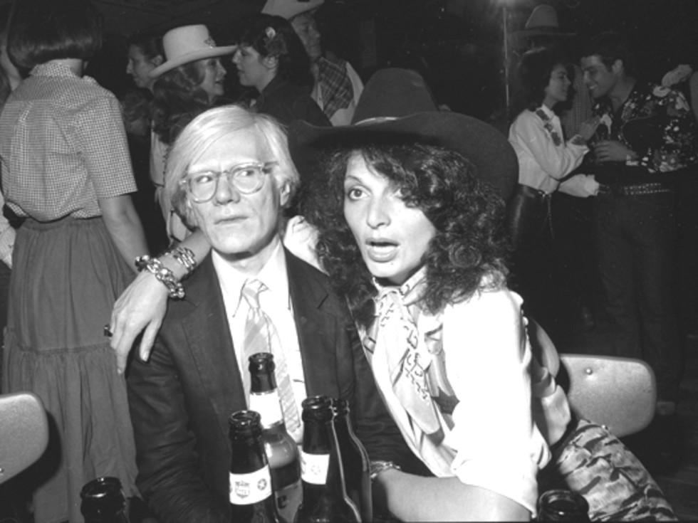 "ndy Warhol and Diane Von Furstenberg at the 1980 premiere of ""Urban Cowboy"" at Gilley's Pasadena."