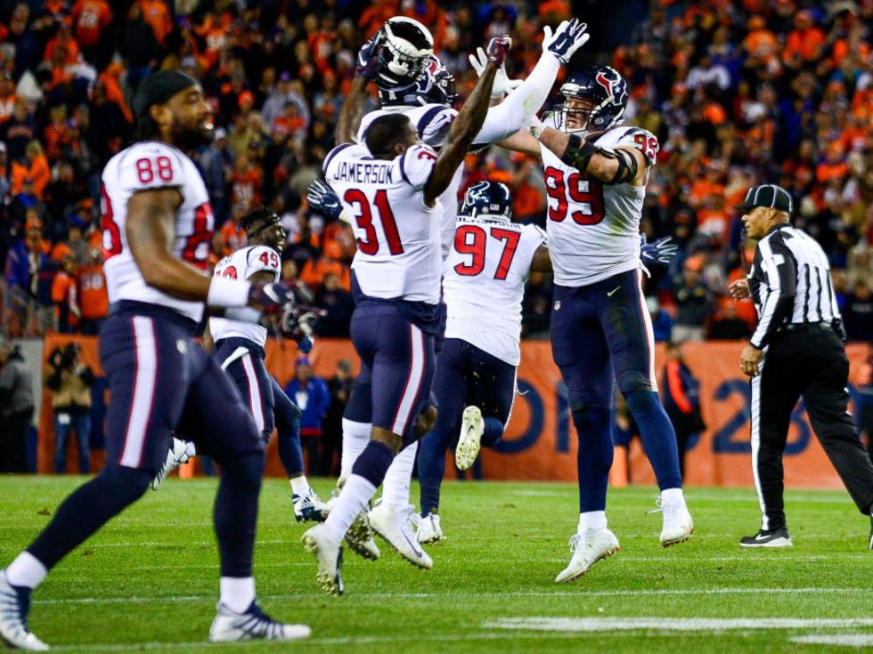Houston Texans jumping celebrating JJ Watt