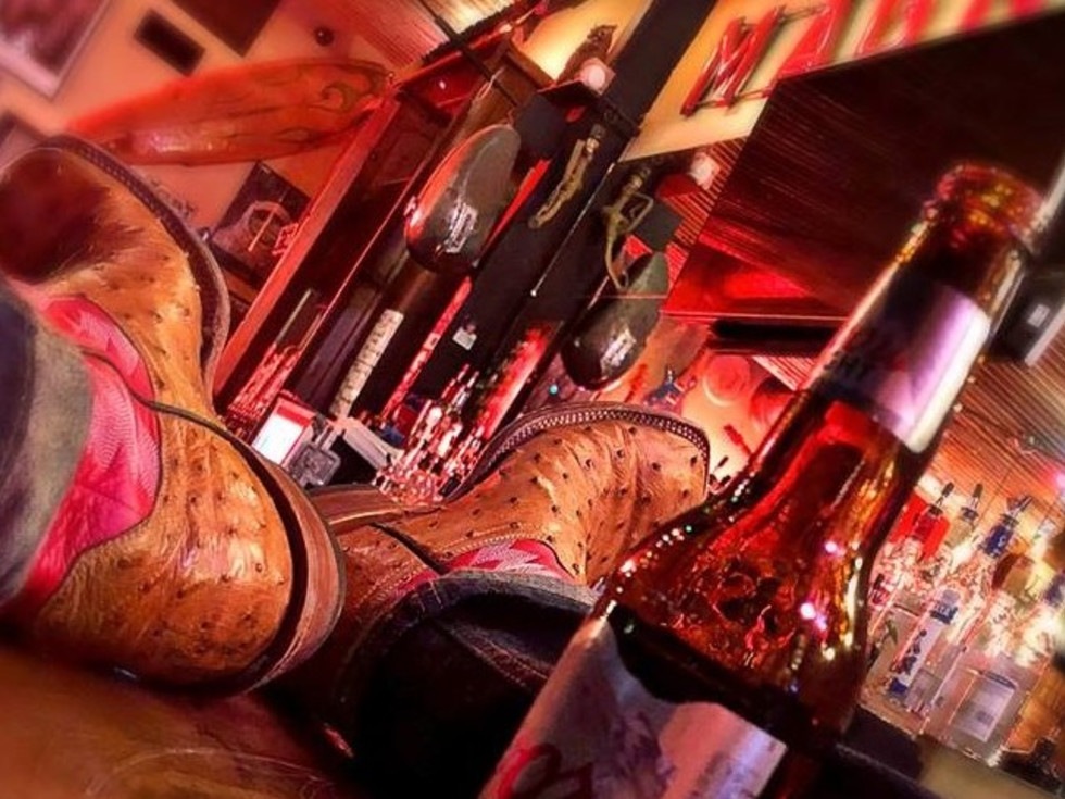 Magnolia Motor Lounge, boots on bar