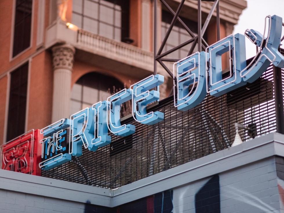 Rice Box River Oaks neon sign daylight