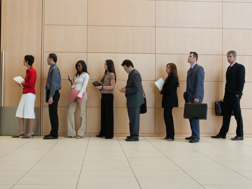 people standing in line waiting in line office