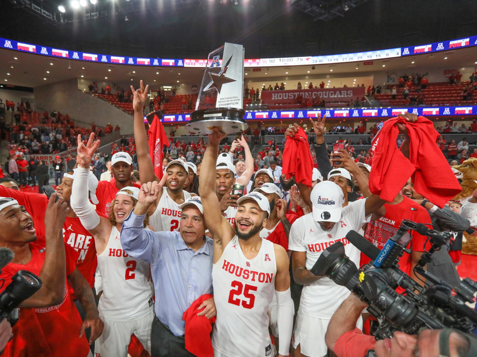University of Houston UH Cougars men's basketball team celebrating