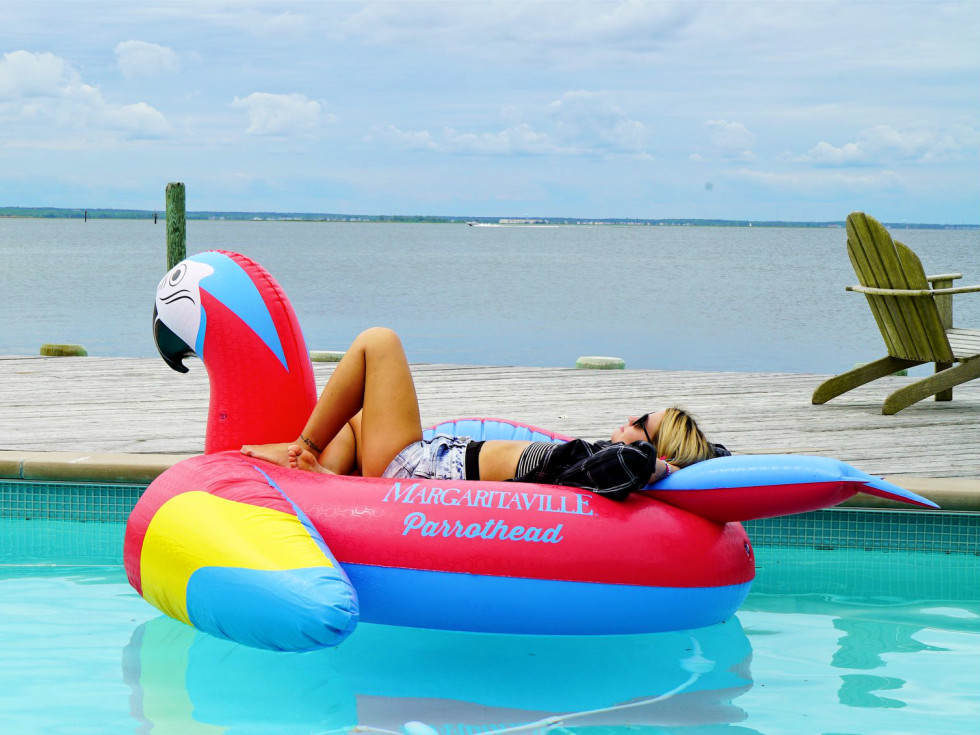 Margaritaville promo shot woman relaxing