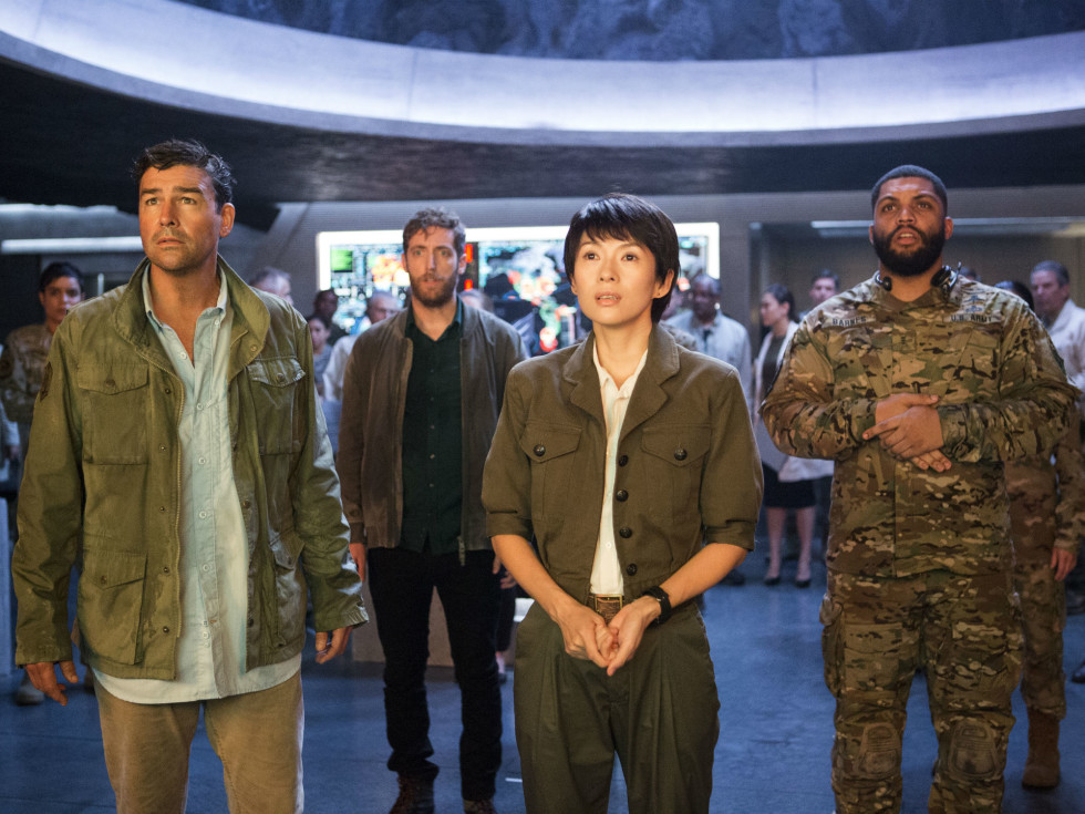 Kyle Chandler, Thomas Middleditch, Ziyi Zhang, and O'Shea Jackson, Jr. in Godzilla: King of the Monsters