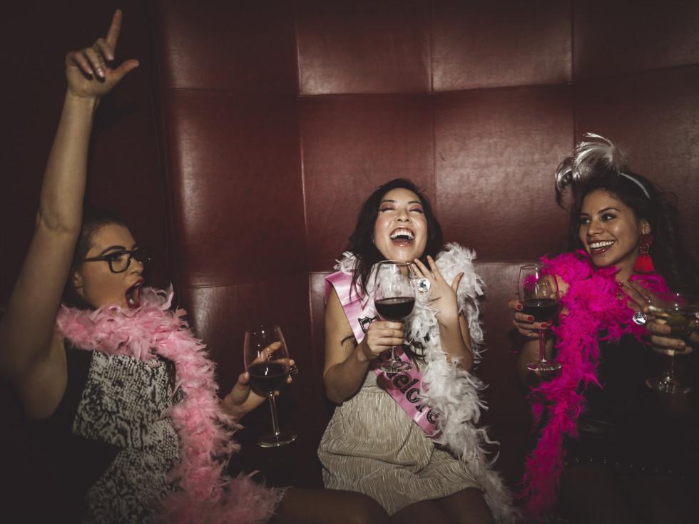 Women laughing drinking wine